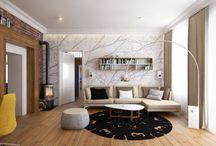 Projekt wnętrza salonu z czerwoną cegłą w kamienicy - Tissu. / Aranżacja wnętrza salonu z czerwoną cegłą w kamienicy. Beżowe wnętrze zostało ożywione poprzez czerwoną cegłę na ścianie oraz wprowadzenie żółtych dodatków.