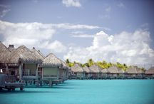Overwater Bungalows in the Islands of Tahiti / Unlike any other properties in the world, the luxury hotels and resorts of Tahiti offer a perfect combination of experience, service, dramatic views, cuisine, ambiance, and accommodations. Here are some images of Tahiti's iconic overwater bungalows-complete with glass floors and a private deck with a ladder to the water.