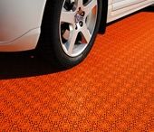 """Garage floor / Bergo Tiles solves problems with cold, damp and dull floors. The Bergo Tiles allows the surface underneath to """"breathe"""", which prevents moisture being trapped and odours forming. You can easily perform the installation yourself."""