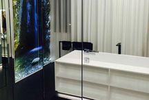 Luxury bathtube with shelves.