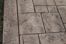Stamped Patterns / Concrete is ideal for creating virtually any unique shape, design or pattern. Its appeal is further enhanced with the ability to customize color. Colored concrete may be used to simulate other outdoor materials, such as brick, slate or flagstone, but it can also subtly blend with nature or boldly make a dramatic statement. This beautiful design option is affordable and works well with other concrete finishing techniques to include broom finishing, sandblasting, exposing of aggregate and more.