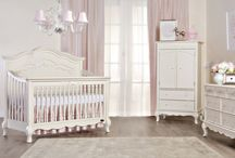 Evolur Aurora Princess Collection / The Evolur Aurora 5 in 1 convertible features a solid full panel headboard decorated for with an array of delicate hand crafted accents including detailed turned spindles, Queen Anne style pedestal feet and intricate ribbon bow scrollwork creating a room, as if taken straight from the pages of a fairytale.  The Aurora Crib pairs perfectly with our enchantingly graceful matching Armoire, Double Dresser and Nightstand. Toddler rail and bed-rail, sold separately.