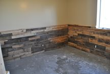 Lake cottage family room / we are thinking to do something like this on the bottom half and do a variety of stains.  Getting rough sawn pine boards and put up horizontally
