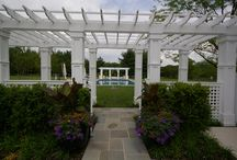 Classical Gardens / A formal garden with swimming pool, pergolas, outdoor kitchen, flagstone patio and brick walls. http://www.gardendesigninc.com