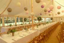 Eleanor & Sebastian, Newby Hall, May 2015 / Our 9m x 16m traditional canvas marquee with clear walls at Newby Hall. Decorated with hanging lanterns, trestle tables and wooden folding chairs