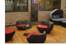 """Chicago Outdoor Patio Furniture Showroom - Clearance Prices / Outdoor Furniture Now opened it's Chicago showroom in the fall of 2013 due to the growth of our commercial partnership channel. Our showroom which is located in the Fulton Market neighborhood showcases a wide range of all-weather wicker and teak patio furniture along with various granite and slate stone items such as fountains, planters and benches. We do offer samples for sale to the general public which allows us to keep a fresh """"look"""" within the showroom."""