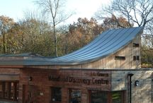 """Ski-Slope"" Roof at the JG Woodland Discovery Centre / This dramatic ski-slope roof nestled in South Yorkshire Woodland was waterproofed with Polyroof 185 as a lightweight and cost-effective alternative to metal. The project won the SCALA Civic Building of the Year Award 2012."
