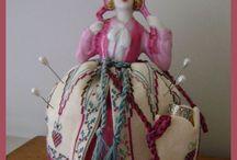 muñecas de porcelana alfileteros