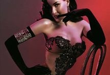 -Dita Von Teese - / (born Heather Renée Sweet on September 28, 1972) is an American burlesque dancer, model, costume designer, author and actress.