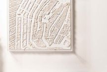 Our cityscapes / This is our 3d city map collection that we make and sell. We hand make these in our studio in Sussex, England. Most are made of plaster. They can be placed on a table or wall hung.