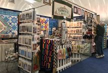 FBQ Booth Photos / Follow us through the years as Tom and I have been vendors at quilt guild shows, and management type quilt shows since 2007 with Flower Box Quilts! We travel in our 31 foot Toy Hauler where the back 1/3 of the RV is our mobile quilt store. We have toured the USA; met many quilters; and have seen a plethora of gorgeous quilts. Quilting IS alive and well in the USA!
