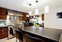 Kitchens / Kitchens serve not only as a place to prepare meals, but also a main gathering area in the home. Look through these photos for kitchen design ideas - large or compact space. www.livinginteriors.net