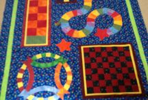 Quiltsmart Game Quilt / Delight a child! Drop it on the floor and this quilt will attract children like a magnet!  #quiltsmart #games #gamequilt #quilt #sewing #quilted #quilting #diy #handmade