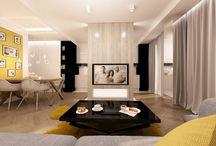 BIAŁO-CZARNY EKLEKTYZM Z NUTĄ ŻÓŁCI. / Aranżacja wnętrza eleganckiego salonu z czarnymi akcentami - Tissu. Strefa dzienna w mieszkaniu, wzbogacona o czarne i intensywnie żółte elementy.