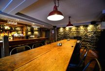 Kings Head, Galway / We supplied barn oak cladding for this project and also made a long sharing table from 200 year old pitch pine planks with handles left on.We also made 2 smaller table tops using these planks.