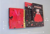 Greeting Card, Gift Tag & Gift Wrap Displays / Point of sale that covers all your greeting card displays - slatwall, wall fixing and free standing POS. Shop Fittings (shopfittings) that include card displays, greeting card display racks, acrylic display stands and those neat little gift card displays.