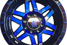 Custom Painted Wheels / Rims with custom clear-coat paint colors, the ultimate way to make your vehicle stand out from the rest. Available on any black and machined wheel from KMC, KMC XD Series, ATX Series, Moto Metal, HELO, Lorenzo, Motegi Racing, American Racing. Call 1-800-232-0734 for pricing.