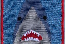 Shark! / mainly crochet has this Shark! throw crochet pattern at http://www.mainlycrochet.org/store/p285/Shark%21.html in Lion Brand's Hometown USA. On sale for Shark Week!