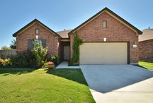 1065 Regency Lane, Round Rock, TX offered at $179,900 / Gorgeous 3 bedroom home on large extended corner lot! Home features beautiful landscaping, two living areas, high ceilings, recessed lighting & spacious floor plan. Lots of windows, providing the home with natural light. Kitchen features brkfst bar & opens to family room. Master boasts double vanity, full bath & walk-in closet. Backyard features large over sized back patio, perfect for entertaining. Amenities include community pool. Great location close to eateries, shopping & major highways!