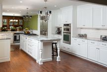 Classical Kitchen Remodel: Delaware, Ohio / A touch of class was added to this kitchen by installing white vanity cabinets, a Viking Range, Kitchen Aid Oven, KitchenAid Dishwasher, Sub-Zero Fridge, Apron Sink, Prep Sink and super white granite countertops,