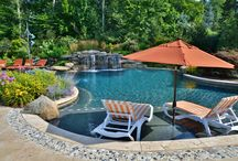 Resort Like Swimming Pool in NJ / A freeform swimming pool with natural stone waterfall, ample patio space, outdoor cabana bar and kitchen, the ultimate backyard for entertaining and summertime parties!