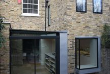 Project: Claremont Square / Glass extension to a Grade II listed home in Islington conversation area. Extensions included a side infill with glass roof and sliding doors as well as a glass window box.