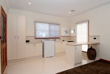 Laundry / Laundry cabinets that Brentwood Kitchens have made .