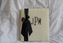 Way Cool Designs / Monogrammed, fabric covered wedding book with pages describing all events leading up to and including the special day.