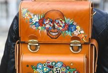 Handmade leather transformer backpack-shoulder / A comfortable men's backpack / messenger bag in a noble brown colour with designs of the Mexican holiday Day of the Dead (Día de Muertos): flowers of the Dead attracting souls, mixed to a beautiful skull Calavera.