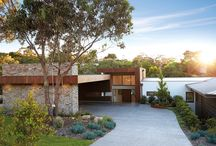 Latitude 37: Glen Shian, Mt Eliza VIC / The clever design integrates with the natural slope, masking the extent of fall and offering stunning treetop views all around while ensuring all parts of the site are accessible and well utilised. The slope allowed for a 4 car garage and workshop, theatre, cellar and gym located beneath the main living zones.