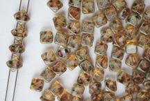 Diagonal Silky Beads | ScaraBeads.com / http://www.scarabeads.com/Glass-BEADS/Silky-Beads/Two-Diagonal-Holes-Silky