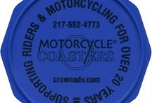 Motorcycle Coaster® Color Samples / Motorcycle Coasters® are available in ten colors.  On this board, you will find photos of both printed and unprinted Motorcycle Coasters® in all ten colors: black, blue, light blue, green, orange, pink, purple, red, white, and yellow.