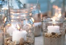 Homemade Seaside Candles / Brighten up your wintery weekend with these pretty homemade candles. Take a little trip to the beach and collect a bit of sand or peoples and pick a few of your favourite shells. Simply melt a little candle wax on the base of a glass vase, jar, bowl or lantern and attach a tall candle to the base, then fill the bottom layer with sand or pebbles and then top with some of your favourite shells in a mixture of colours, shapes and sizes. Enjoy!