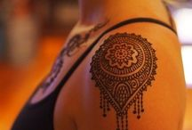 Tattoos and piercings / by Cara Scheidler
