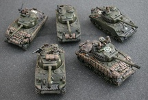 Flames of War / Flames of War is a World War II tabletop game where you use armies represented by painted miniature tanks, soldiers, artillery, and aircraft against another similar opponent's force.