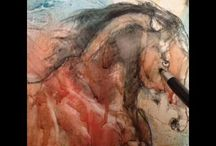 Live horse drawing or painting in video