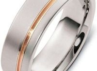 """Mens Titanium Wedding Bands / There are several good reasons for the emergence of titanium as an acceptable alternative to create all types of mens jewelry items including mens titanium wedding bands.  Also called the """"space age metal"""", Titanium is a strong, lustrous, corrosion-resistant silver colored metal. Though titanium is not classified as a precious metal, it has a brilliant luster like precious metals and lends a desirable degree of shine to jewelry crafted out of it."""