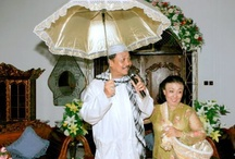 """My Family / """" is it the correct time and place to use umbrella ?"""", my wife asked me. """" Yes it is. I just want to show my love by demonstrating caring and sharing everything with you """", I replied."""
