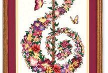 schema chiave di sol con fiori e farfalle