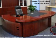 Large Executive Desk - Chicago Previous Model / Included within the Executive Desk: 4 Box drawers 3 Hanging file drawers  1 CPU cabinet 1 Printer cabinet with slide out shelf 1 Storage cabinet 1 Keyboard drawer 1 Inlay leatherette writing pad...........................................................                                                                                                          We are currently sold out of this executive desk. Please see the new Chicago Executive Desk model