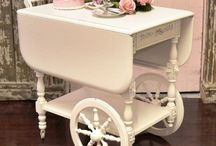 candy , carts , tea trollys . / sweets and buns served in  colourfull dishes trays trollys and all types of carts