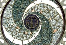 sewer covers / pieces of metal art stuck in streets all over the world.