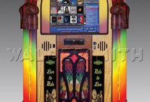 RockOla Digital Jukeboxes  / These Rock-Ola Digital Jukeboxes hold 13000 downloaded tracks or connect your iPod via bluetooth. Made in California, sold in Great Britain. Delivered and Serviced Worldwide.