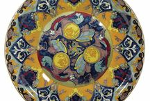 Work by my great grandfather Anton Muller, for Colenbrander, RAM, Arnhem, the Netherlands / My great grandfather Anton Muller worked for the Ram 'plateel fabriek' in the early part of the 20th C. Ram was set up by designer A.C Colenbrander in Arnhem, the Netherlands. My great granddad was one of the decorators responsible for painting the designs on the earthenware in the 1920's. We're always on the look out for his work, distinguishable by by his handwritten maker's mark 'am' at he bottom of the piece, but his work is pretty hard to find.