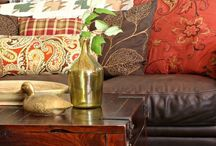 Decorating brown leather sofa with pillows selling my house