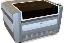 Laser Cut Wood, Acrylic, & Metal - Boss HP-4055 / This CO2 laser machine can laser engrave or cut organic and metal materials.