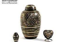 Black and Gray Cremation Urns / Terrybear products are available at your local funeral home.