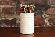Workspace Hacks / Today we're sprucing up our workspace and want to keep things a little cozier. We've been seeing wool accessories all over the place, and they have a uniquely chic look that we definitely dig. Armed with soup cans, felt, VELCRO® Brand Products and neon thread, it's easy to create this bunch of striped pencil pots and planters.
