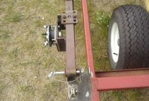 Drop bed axle