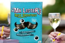 Mr Lister's Quiz Shootout - (Party & Trivia Board Game) / Our Game Mr Lister's Quiz Shootout is a Party & Trivia card game which is part of our range of board games. A Russian roulette trivia game with brains instead of guns.   Mr. Lister puts on the moustache, asks a multi-answered question and players fight to stay in the game. Get it wrong you're out; get a golden answer, you're straight to the shootout round! Great for dinner parties, birthday or Christmas present! Purchase from Amazon:  http://www.amazon.co.uk/dp/B013P7BISC